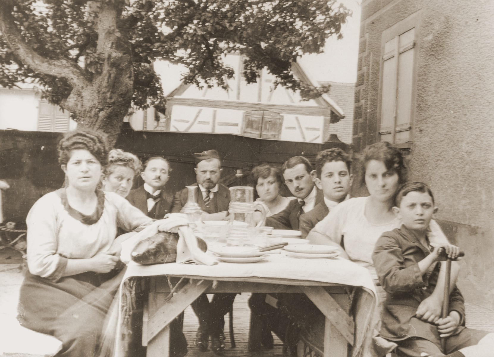 The Schwab family (the donor's maternal grandparents) seated around the table in Mommenheim, France.