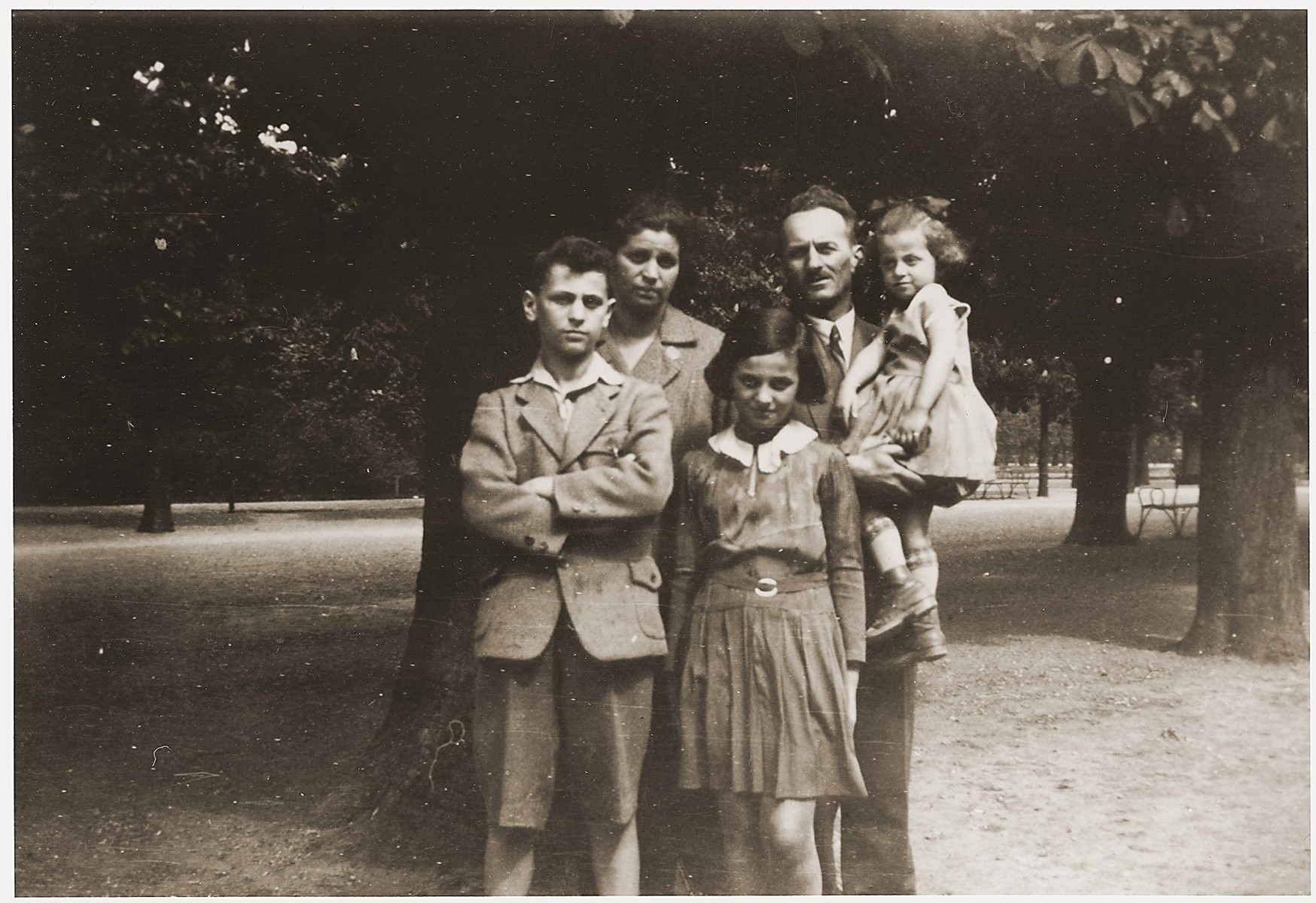 The Spritzer family poses in a park in Vienna.  Pictured are Max and Elsa Spritzer with their three children, Julius, Suzanne and Lisbeth.