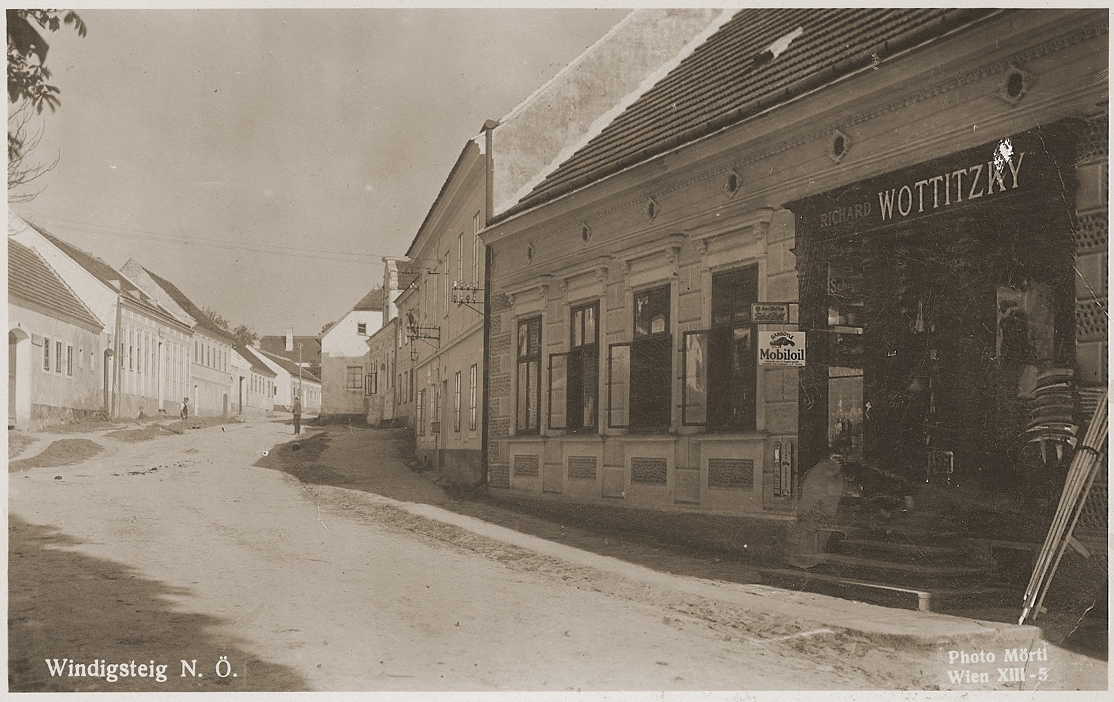 Picture postcard of a street in Windigsteig, Austria, featuring the Wottitzky family general store.
