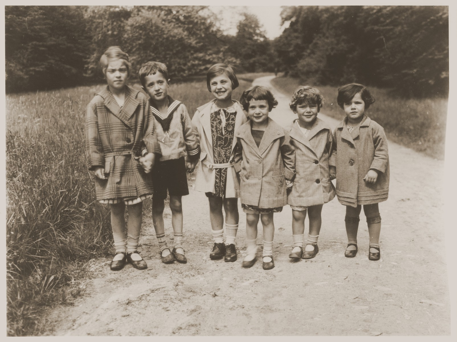 Lore Gotthelf (far right) with friends.  Pictured from left to right are: Elspeth ?; Rudolf Windmuller; Elspeth's sister, Margaret; Ursel Wertheim; Hanna Windmuller; and Lore Gotthelf.