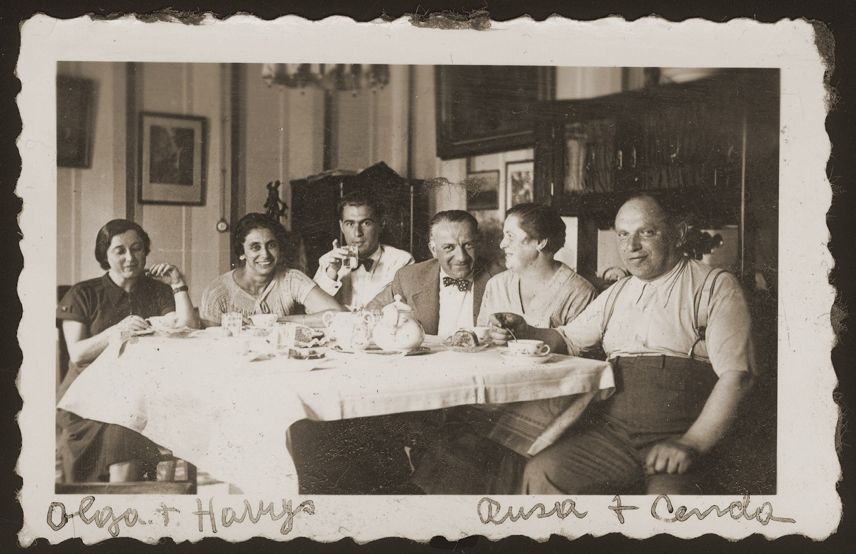 Engagement party for Herman Weigl and Olga Goldstein.    Pictured from right to left are Cenek and Ruzena (Goldstein) Lustig;, unknown; Herman; unknown; and Olga Goldstein.  Herman and Olga (Goldstein) Weigl (the donor's aunt) lived in Prague, where Herman worked as a dentist.  They had a son, Tomas (b. 1937).  All three perished during the war.