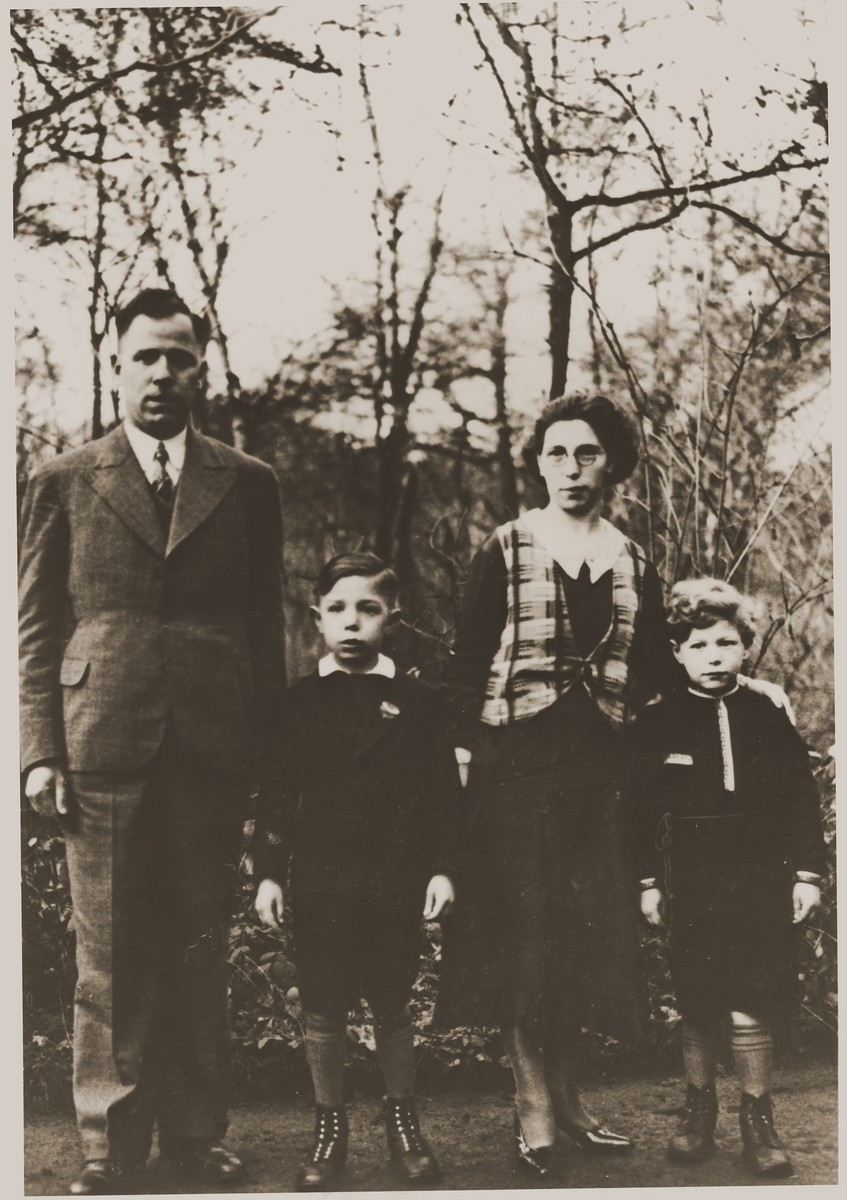 Portrait of the Bluschtein family.    Pictured from left to right are Abram, Julien, Adele and Arnold Bluschtein.