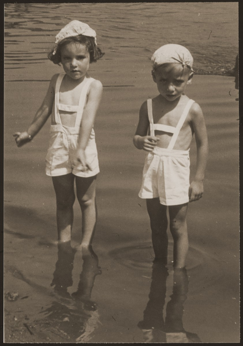 The child twins Rene and Renate Guttmann, wade in the water during a family vacation.