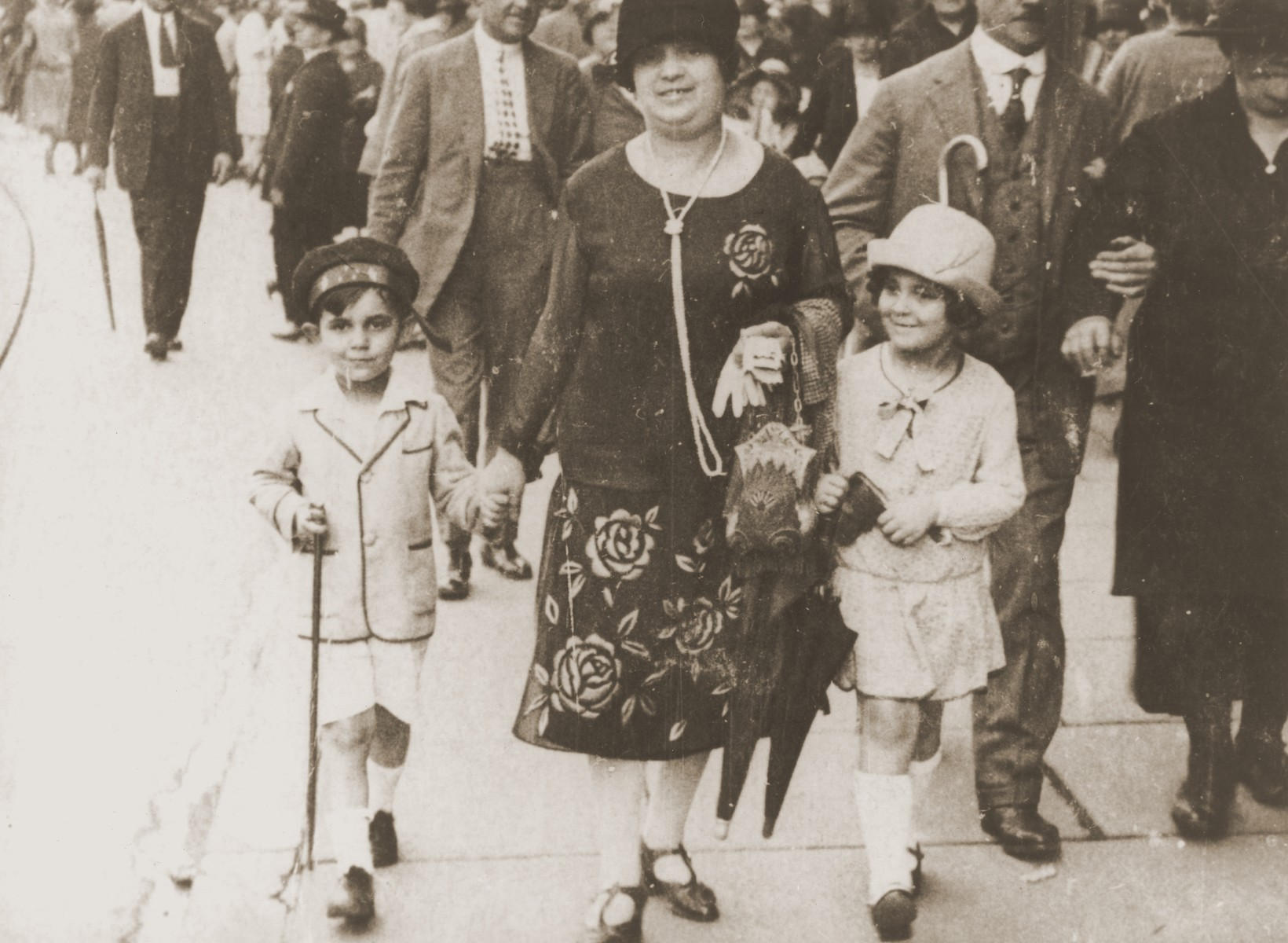 Simone Weil with her mother and brother on a street in Strasbourg.