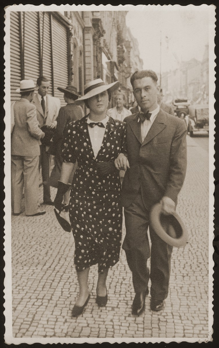 Herman and Olga Weigl walk down a street in Prague.  Herman and Olga (Goldstein) Weigl (the donor's aunt) lived in Prague, where Herman worked as a dentist.  They had a son, Tomas (b. 1937).  All three perished during the war.