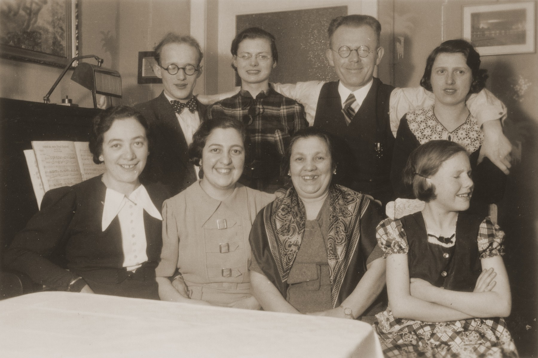 Group portraits of members of the Guttmann and Aisenscharf families in Dresden.    Among those pictured is Ita Guttmann (seated on the far left).