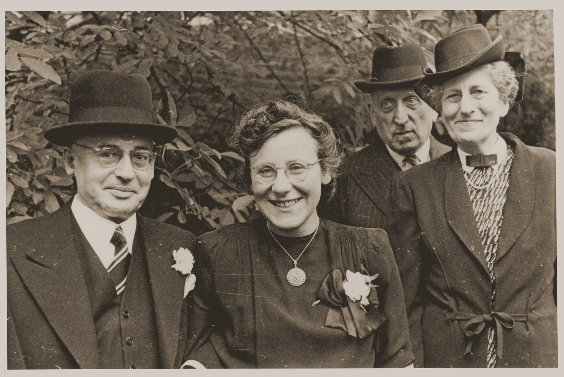 Guests at the wedding of Lore Gotthelf and Erwin Jacobowitz at the Buckland Crescent Synagogue in London.  Pictured from left to right are: Hugo and Emmy Marx, and Mr. and Mrs. Blum.