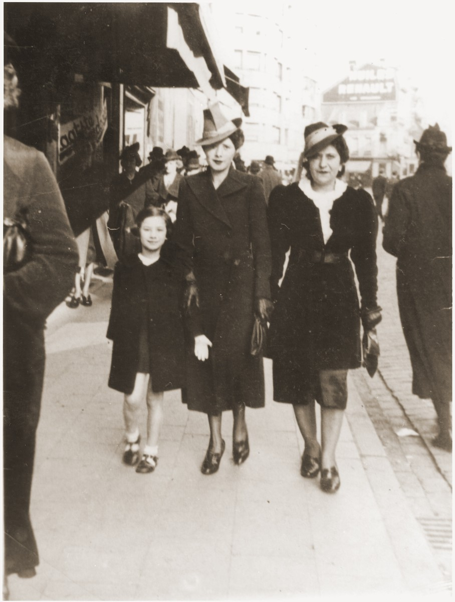 Esther Rosenbaum (middle) walks along a commercial street in Antwerp with her daughter, Frida, and a friend.