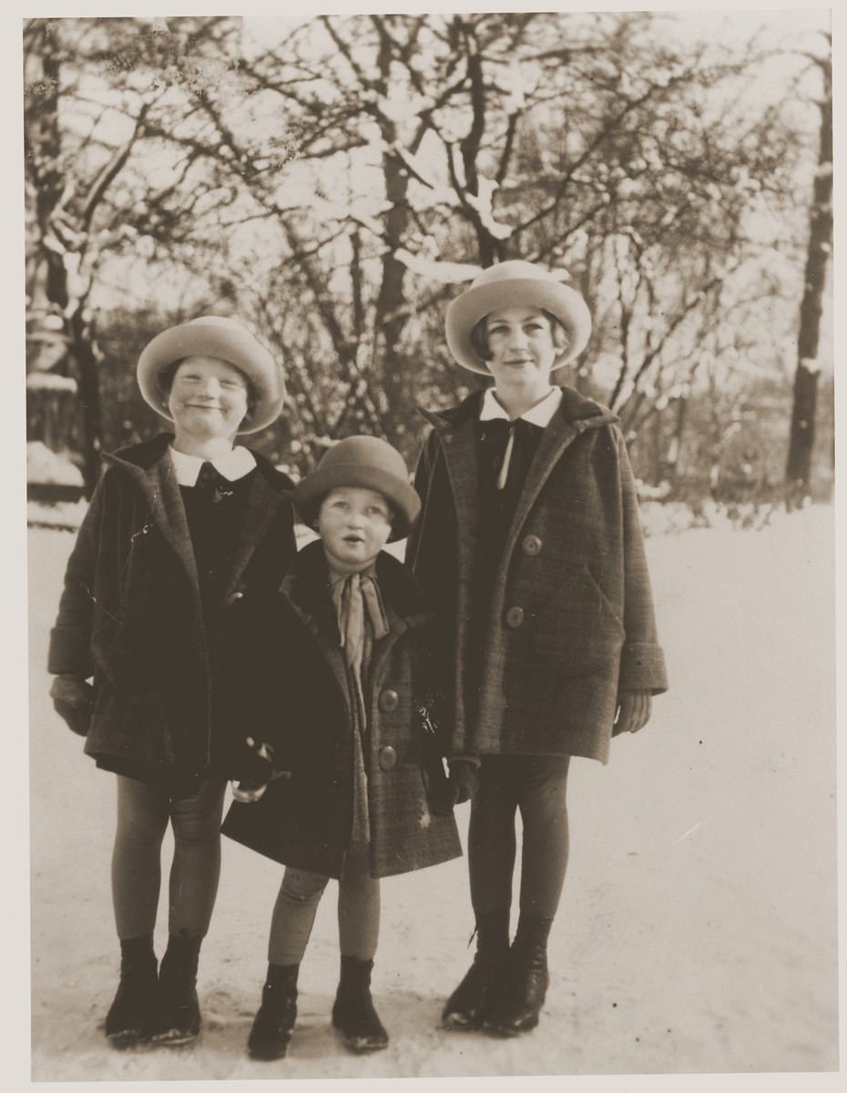 Three Jewish sisters pose outside in the snow.  Pictured are Trudel, Miri and Emmi Farntrog.