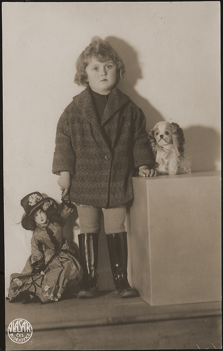 Studio portrait of Ruth Wottitzky with a doll and stuffed animal.