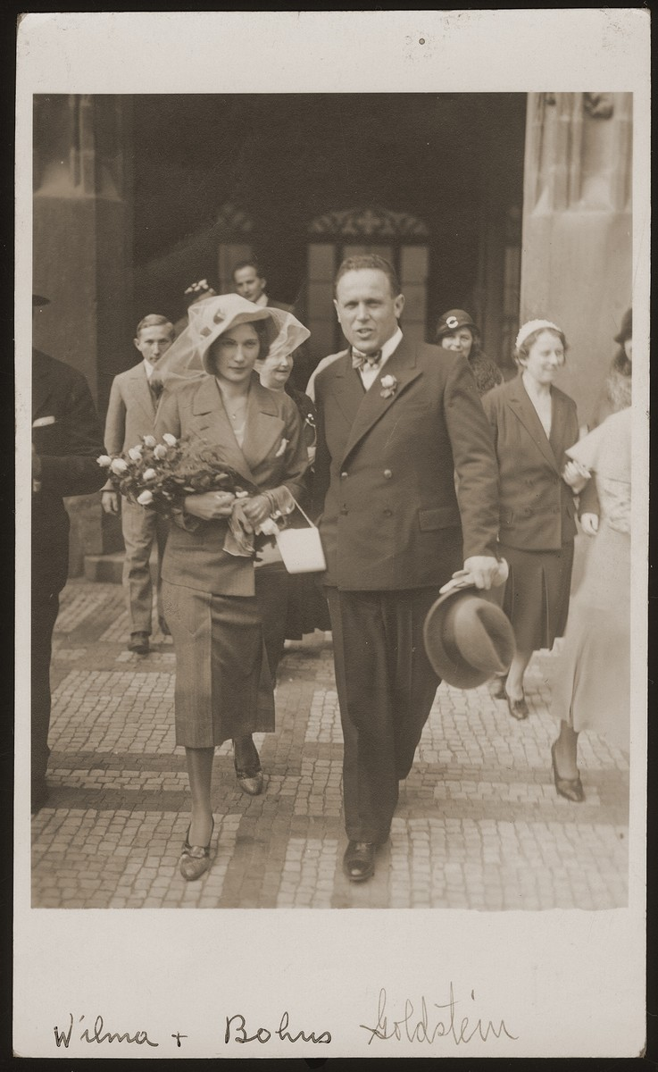 A Jewish couple leaves the synagogue after their wedding.  Pictured are Bohus Goldstein and his wife, Wilma Redlich.  The couple later had two children, Eva and Michael.  All four perished during the war.