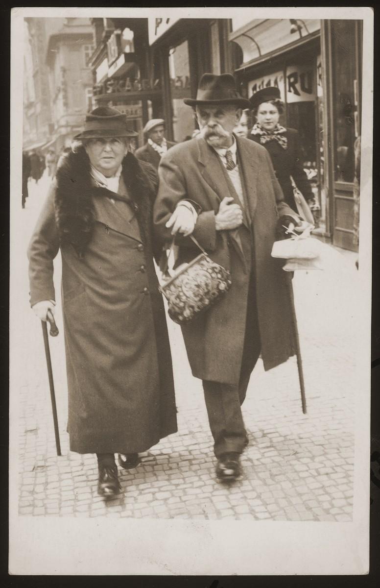 Julius and Fanny Goldstein walk along a street in Tabor, Czechoslovakia.