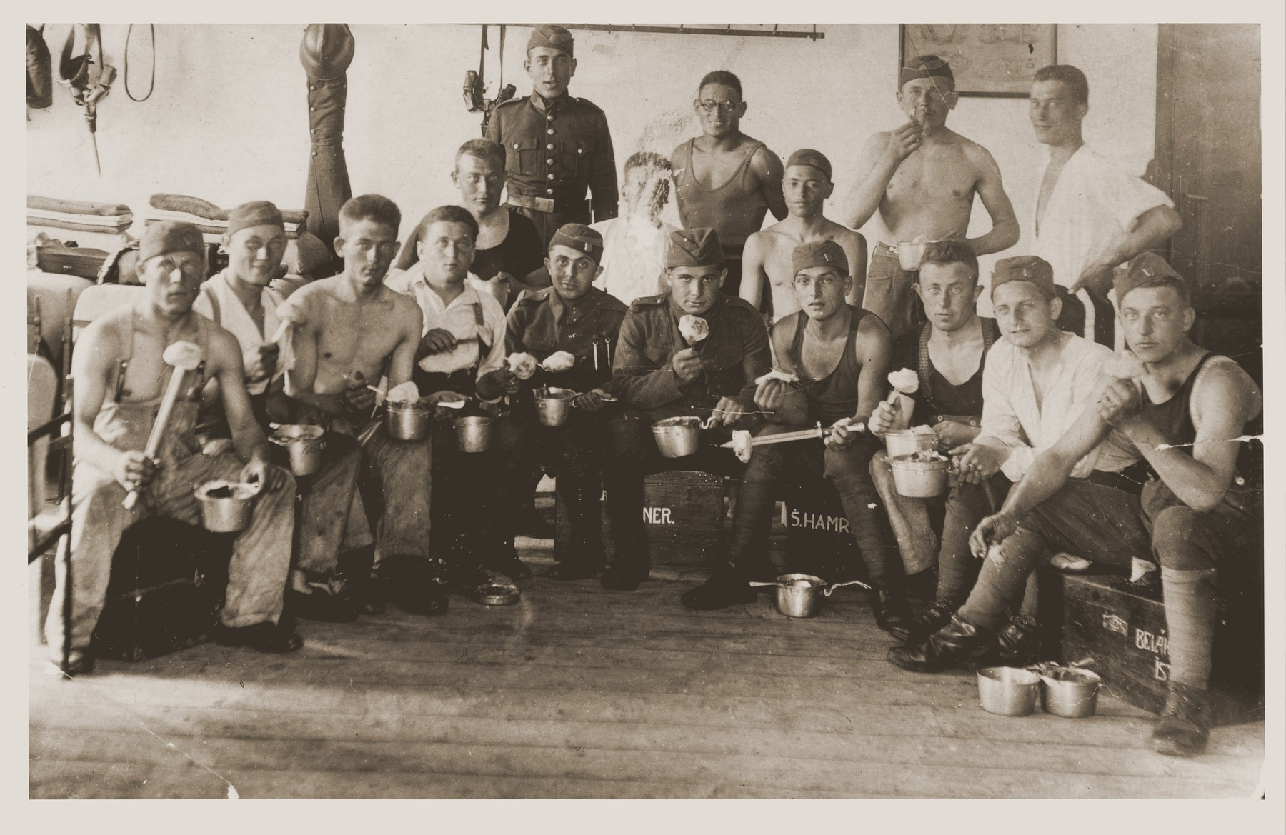"""Group of Czech soldiers, some Jewish, eating potatos.  Among them are Herman Berkovits.  He inscription on the back reads """"For Herman, my friend, from Kalman Sonenschein."""""""