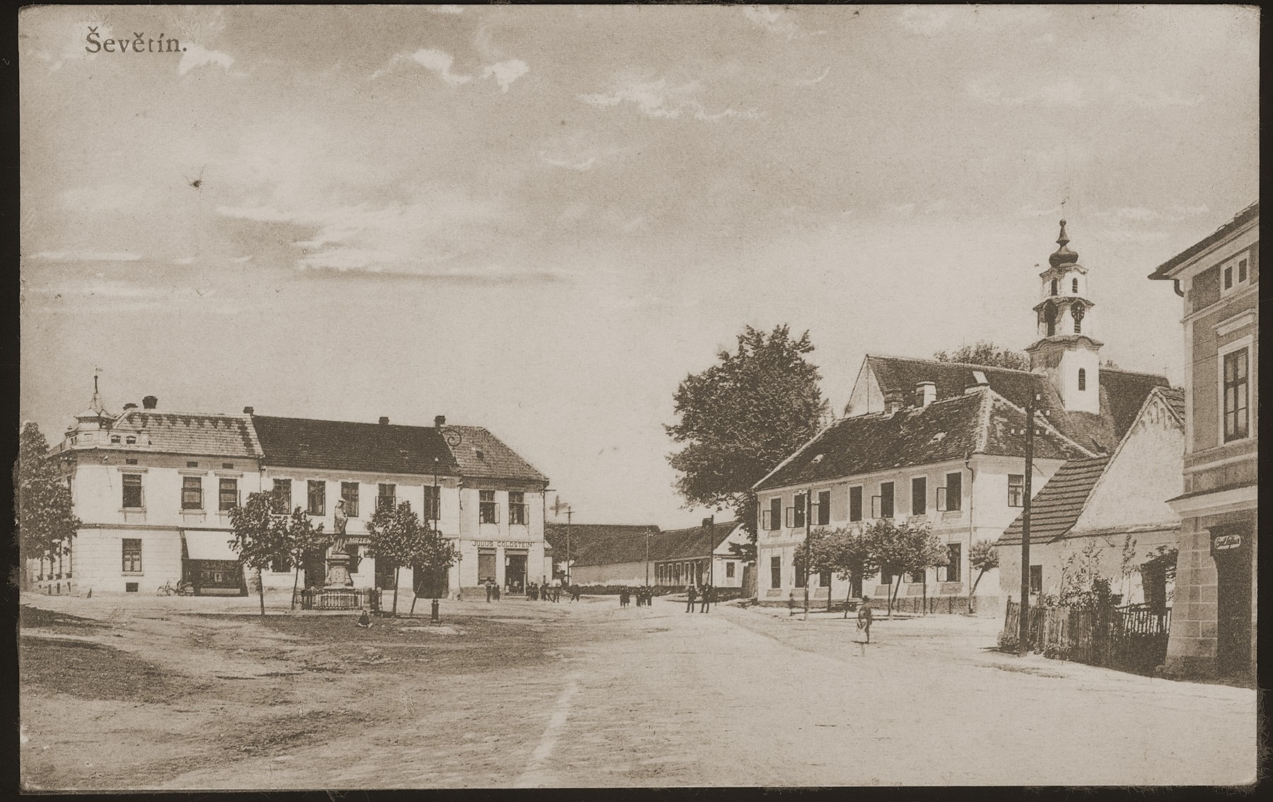 Picture postcard of the market square in Sevetin, Czechoslovakia.    Julius Goldstein's general store is visible at the center left.
