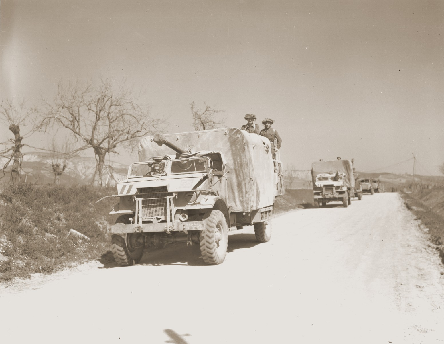 A convoy of Jewish Brigade trucks transports Jewish Brigade soldiers and artillery to the front line in Italy.