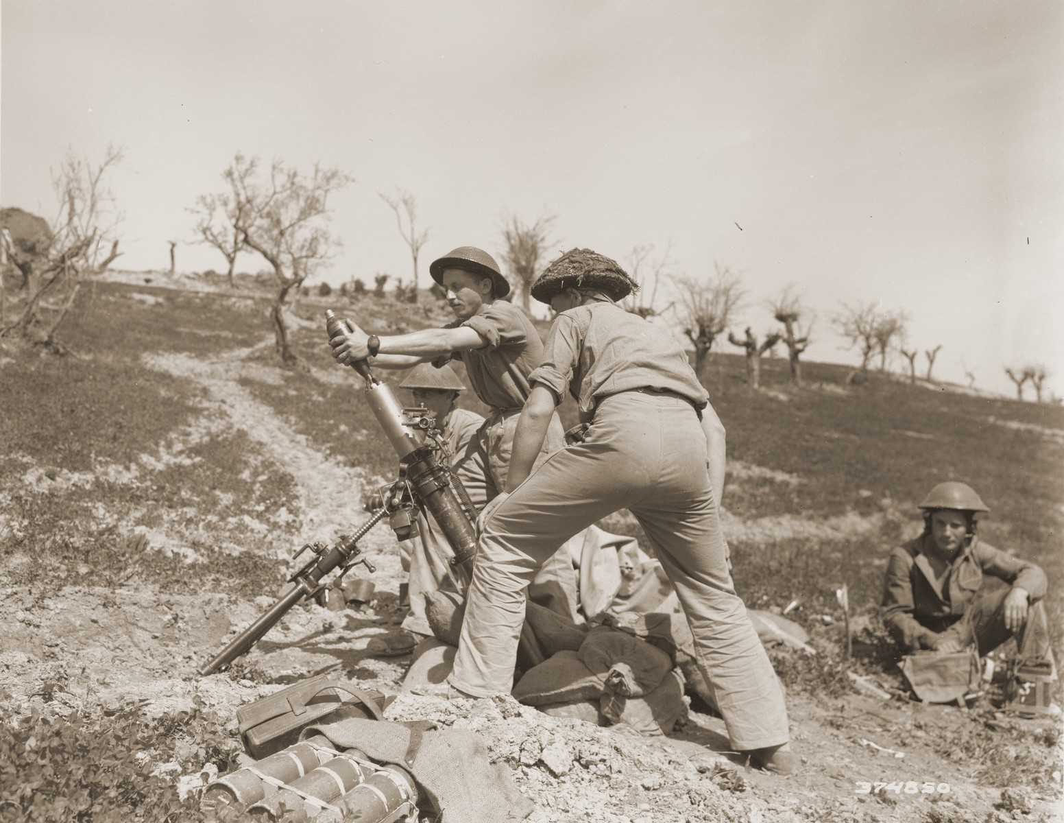 Three Inch Mortar Crew of the Jewish Brigade prepare to open fire.