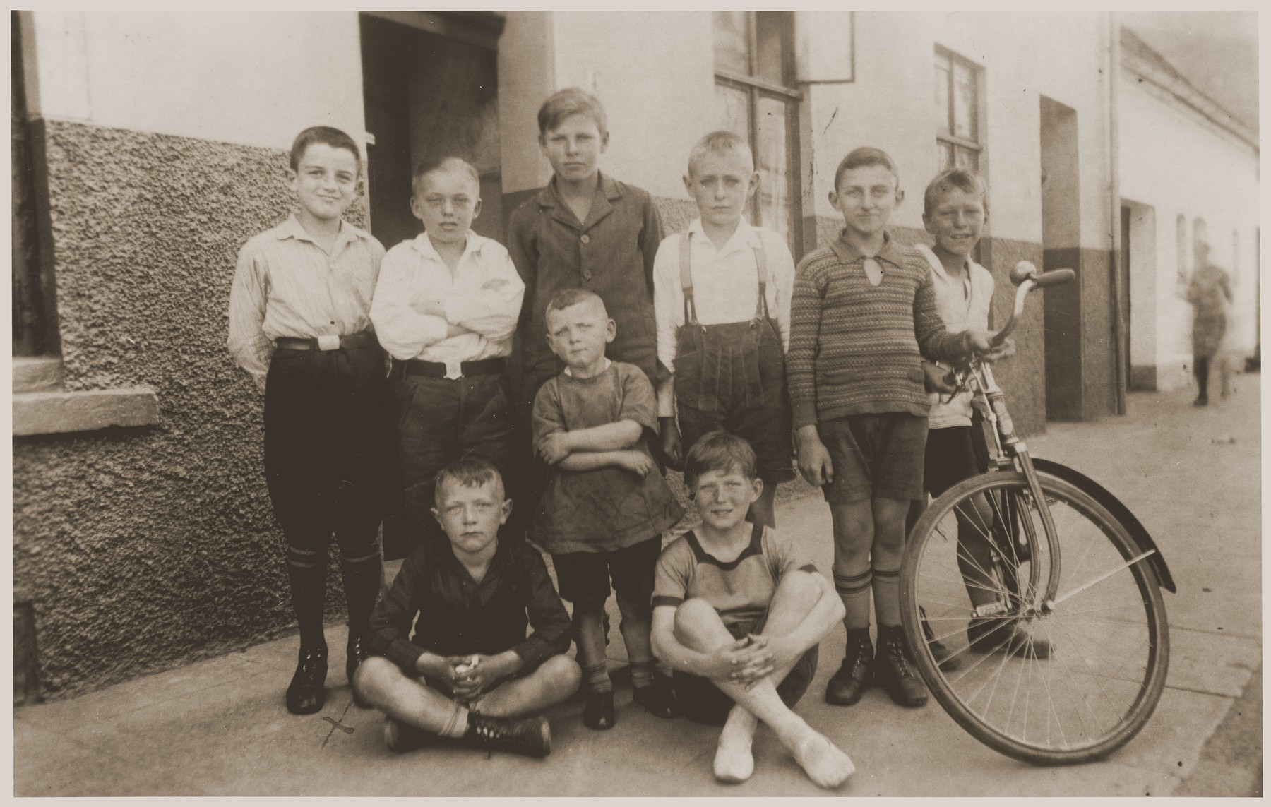 Beno and Gerd Zwienicki (standing first and second on the right) pose in front of their father's bicycle shop with a group of non-Jewish children from the neighborhood.    Beno and Gerd Zwienicki left Germany in 1939 after having endured their mother's murder and their own arrest on Kristallnacht.  One of the German boys later became a guard at the Bergen-Belsen concentration camp.