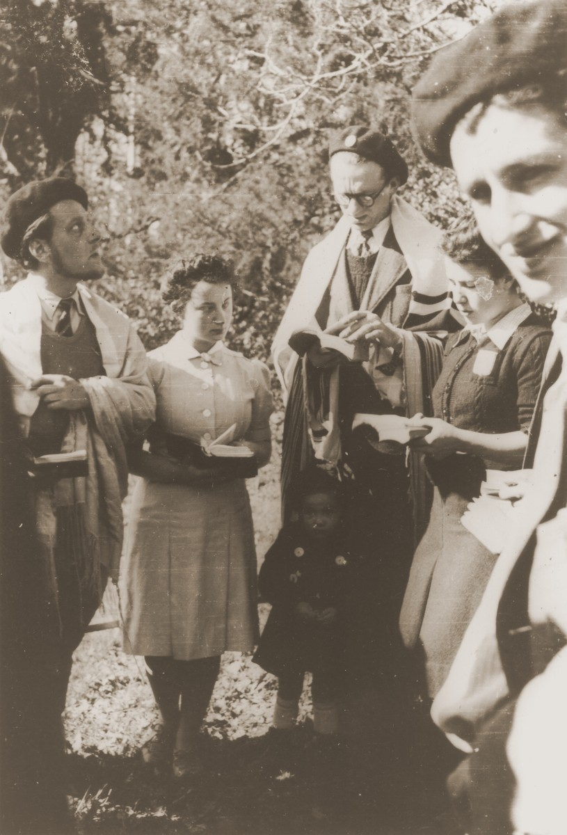 Leo Cohn, a Jewish refugee from Germany who directed the youth center in Strasbourg, leads religious services at an encampment of the Eclaireurs Israelites de France [Jewish Scouts of France].    Leo Cohen was killed during the war.