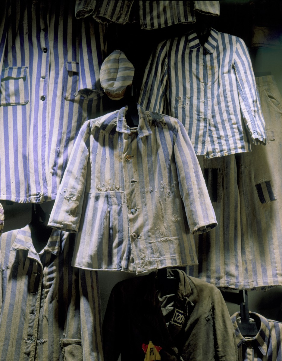 Display of concentration camp prisoner uniforms in the permanent exhibition of the U.S. Holocaust Memorial Museum.