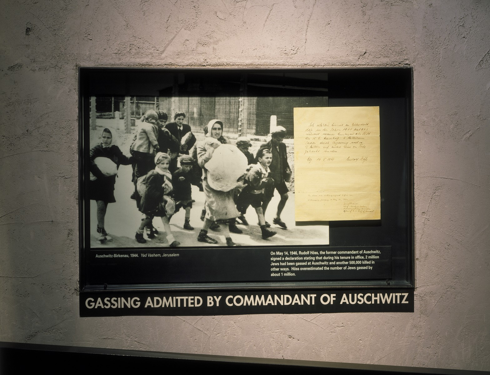 Auschwitz photo mural and affadavit signed by Auschwitz commandant Rudolf Hoess, displayed on the third floor of the permanent exhibition at the U.S. Holocaust Memorial Museum.  The affadavit, dated May 14, 1946, states that during Hoess' term as commandant two million inmates were gassed and 500,000 were killed in other ways at Auschwitz.