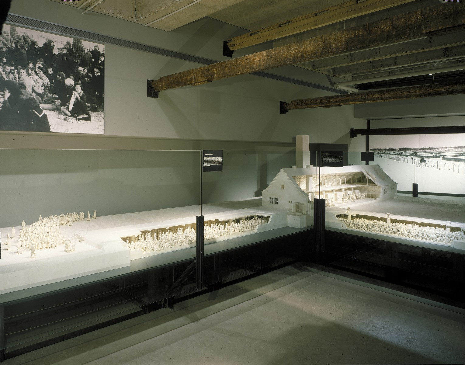 View of the scale model of crematorium II at Auschwitz-Birkenau on display in the permanent exhibition of the U.S. Holocaust Memorial Museum.  The model was sculpted by Mieczyslaw Stobierski based on contemporary documents and the trial testimonies of SS guards.  This model, which is a recreation of the sculptor's model that has been on display in the State Museum of Auschwitz for many years, was commissioned by the U.S. Holocaust Memorial Museum for placement in the permanent exhibition.