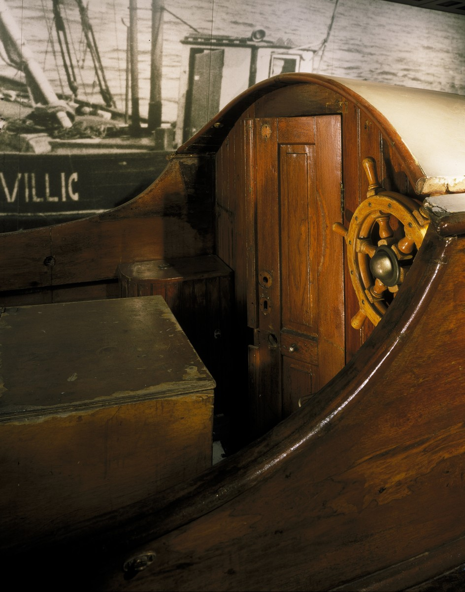 """Detail of the Danish fishing boat displayed on the second floor of the permanent exhibition at the U.S. Holocaust Memorial Museum.  The boat was used by a group code-named the """"Helsingor Sewing Club"""" to carry Jews to safety in Sweden."""