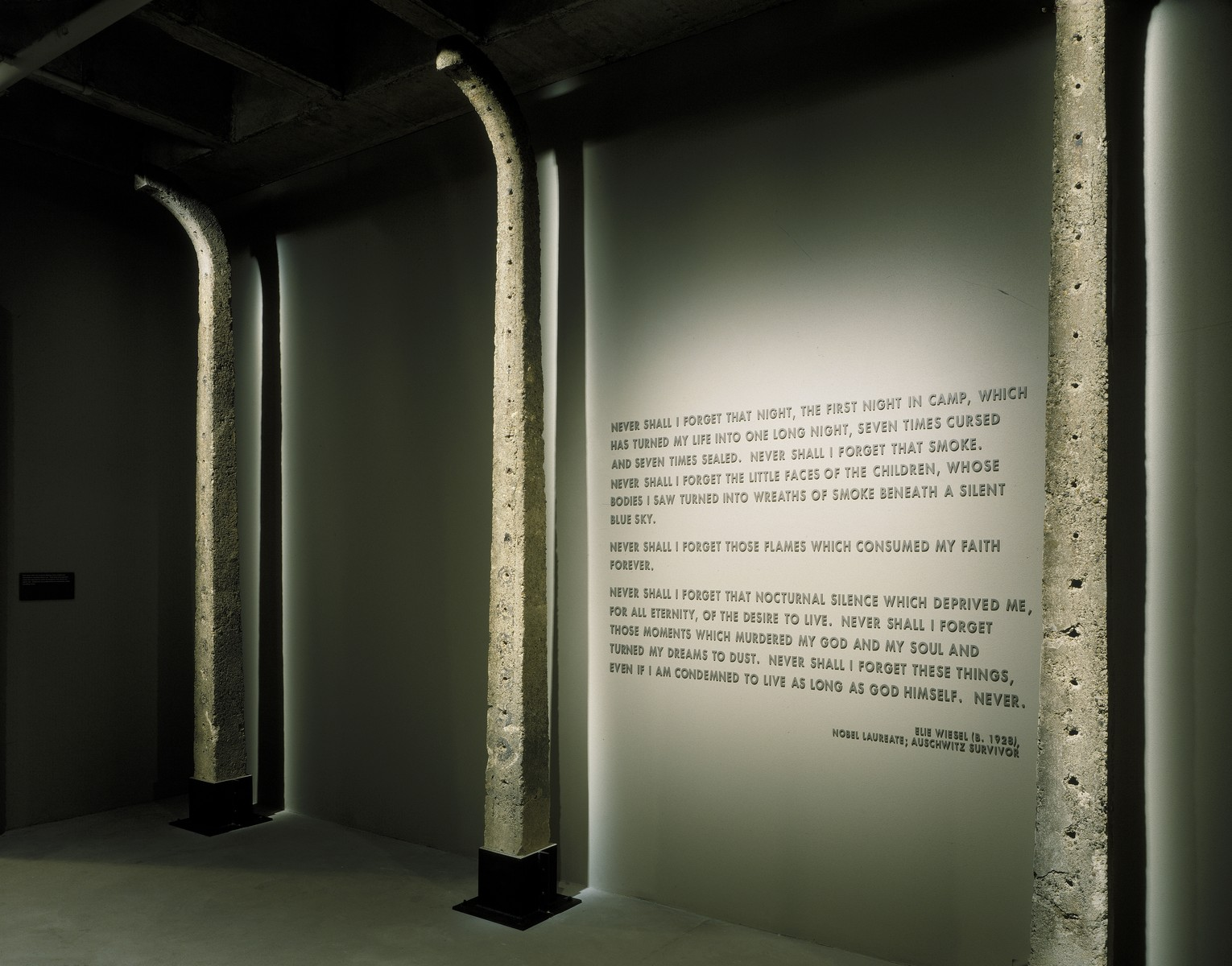 Auschwitz fence posts and Elie Wiesel quote in the third floor tower room of the permanent exhibition at the U.S. Holocaust Memorial Museum.