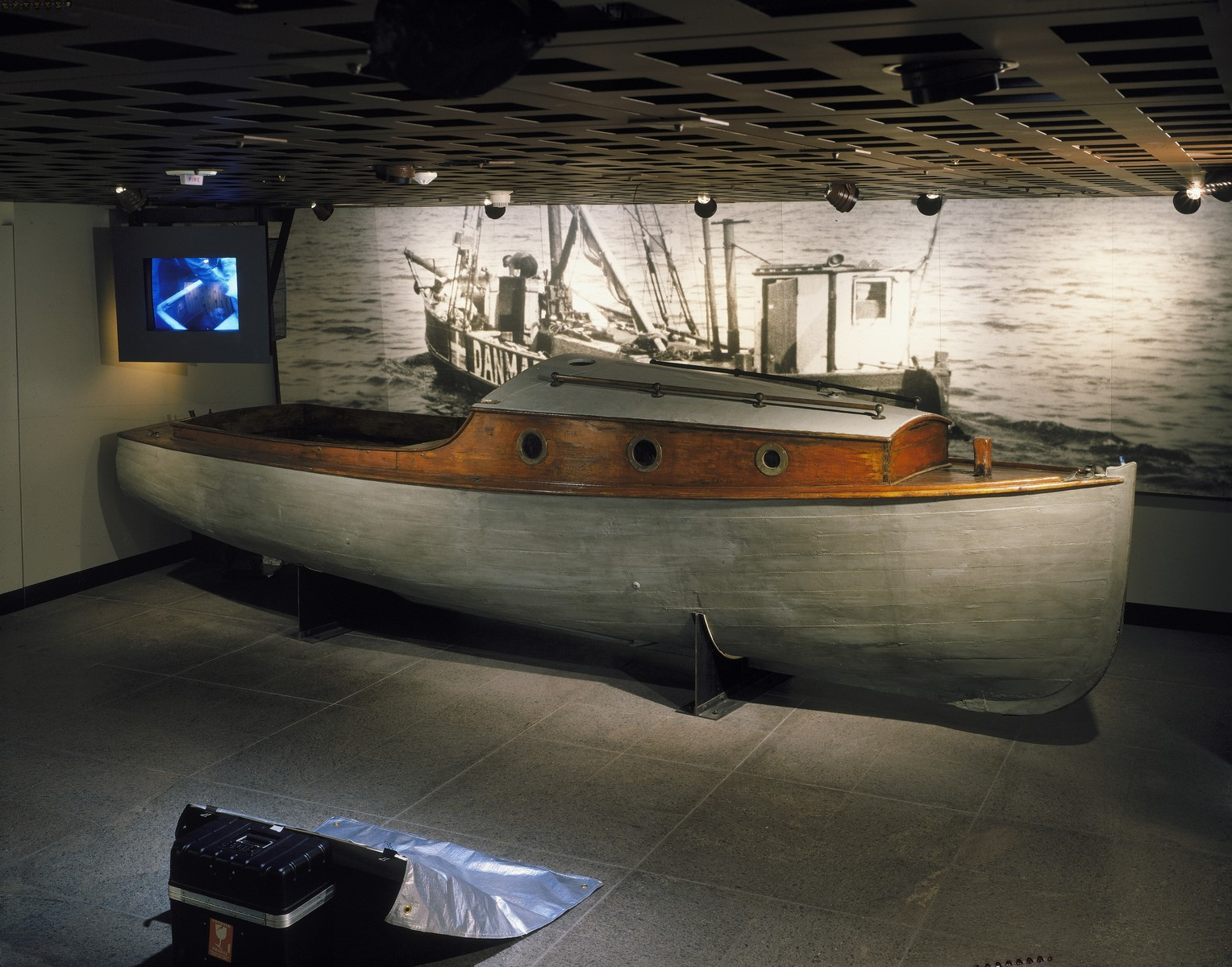 "View of the Danish fishing boat and monitor on the second floor of the permanent exhibition at the U.S. Holocaust Memorial Museum.  The boat was used by a group code-named the ""Helsingor Sewing Club"" to carry Jews to safety in Sweden."