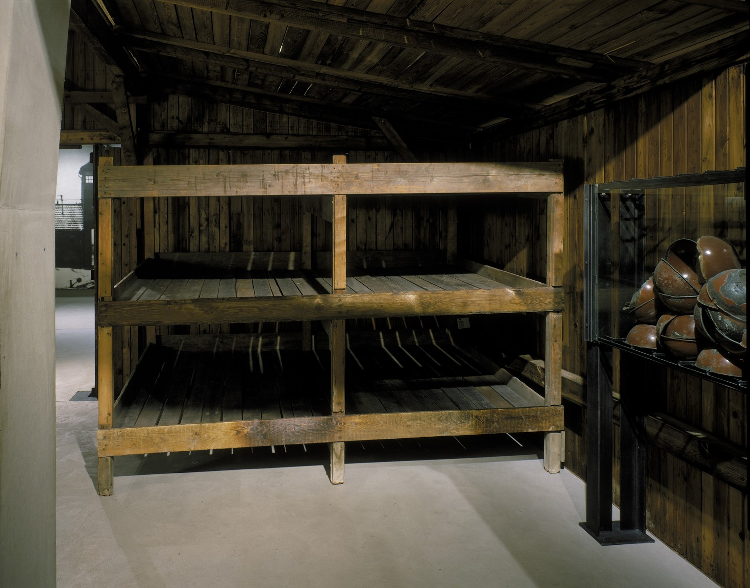 Prisoner bunks and food bowls in the reconstructed Auschwitz prisoner barracks displayed on the third floor of the permanent exhibition at the U.S. Holocaust Memorial Museum.