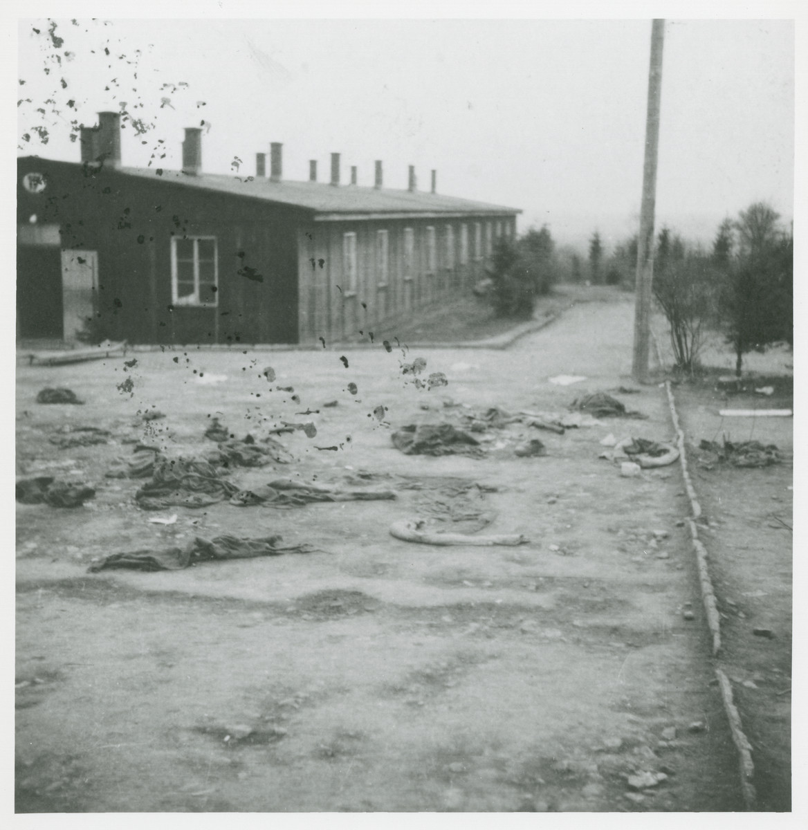 Prisoners' clothing and a barracks in the Ohrdruf concentration camp after liberation.
