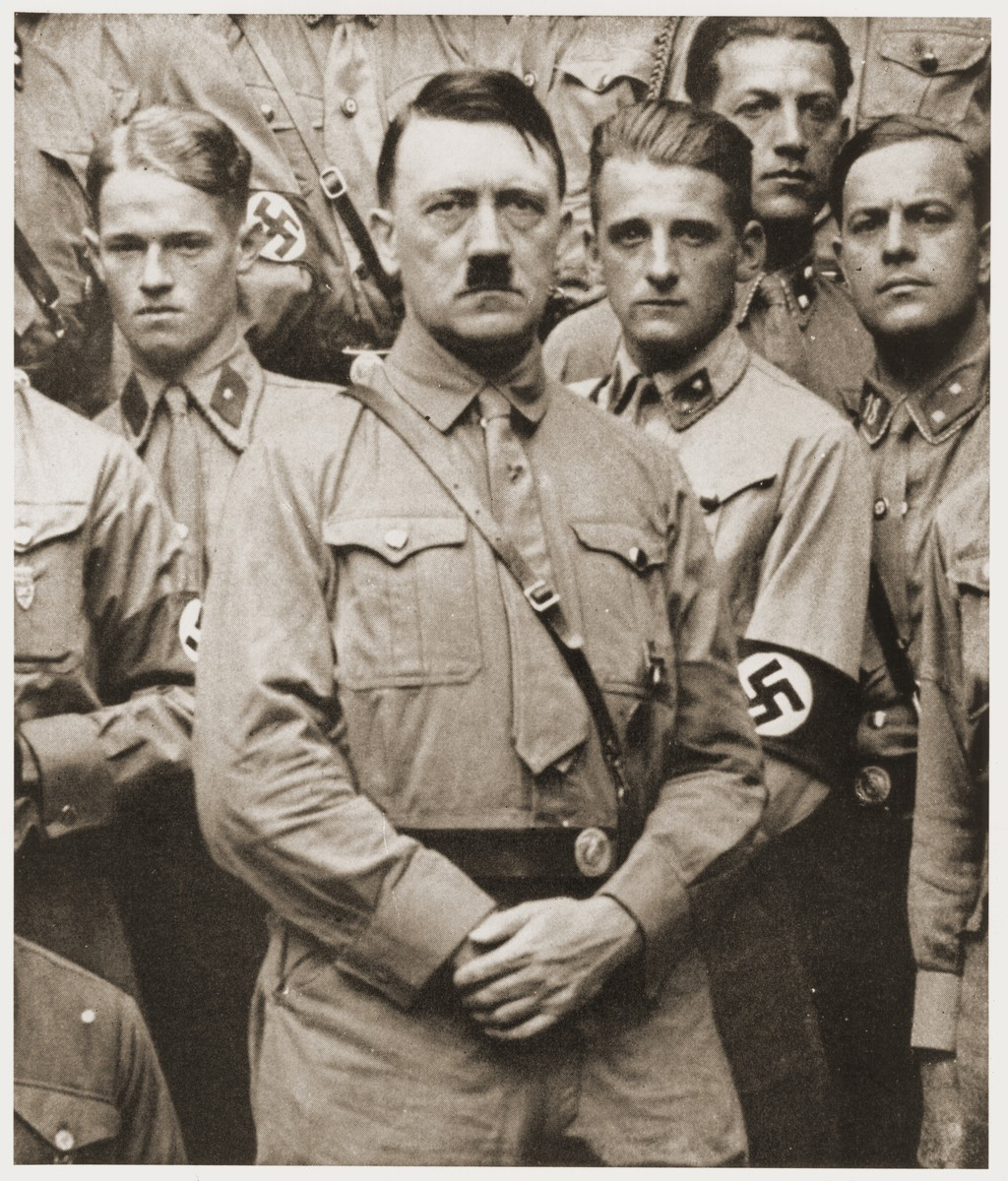 Adolf Hitler poses with a group of SS members soon after his appointment as Chancellor.
