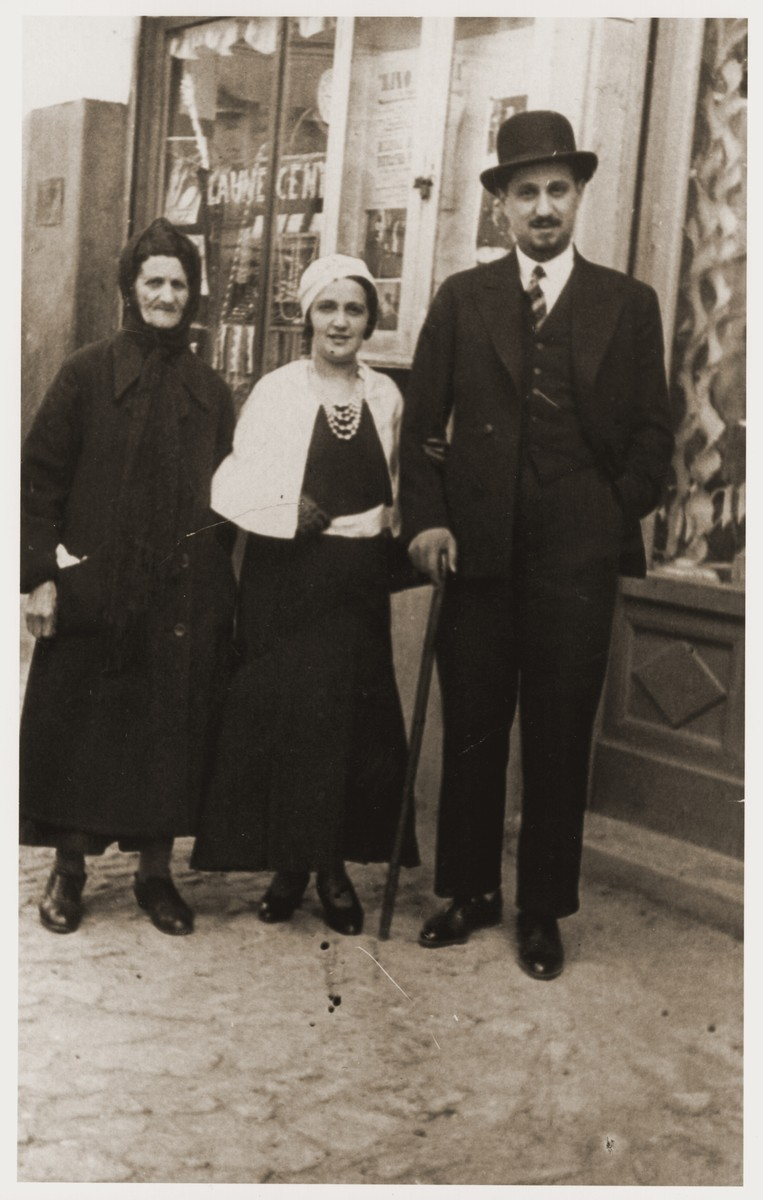 Portrait of Helen Berkovic Goldberger, her husband Cantor Eugene Goldberger and a wet nurse on the streets of Vukovar.