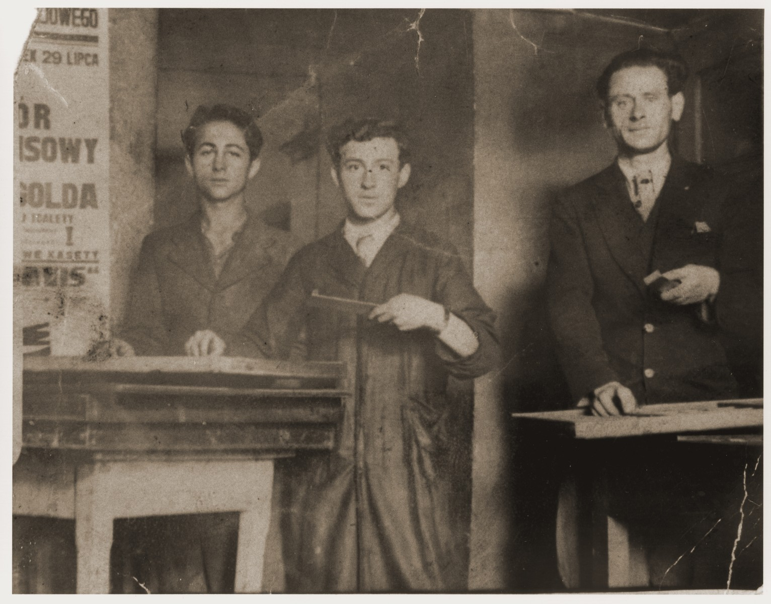 Three Jewish typesetters pose in a print shop in Krynica.    Pictured from left to right are: ? Lernbojm, Berl Moncznik and Benjamin Checinski.