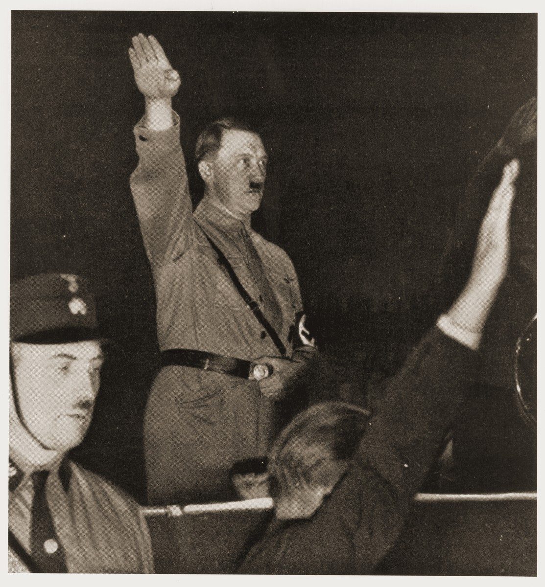 Adolf Hitler salutes his followers at a Nazi Party rally soon after his appointment as Chancellor.