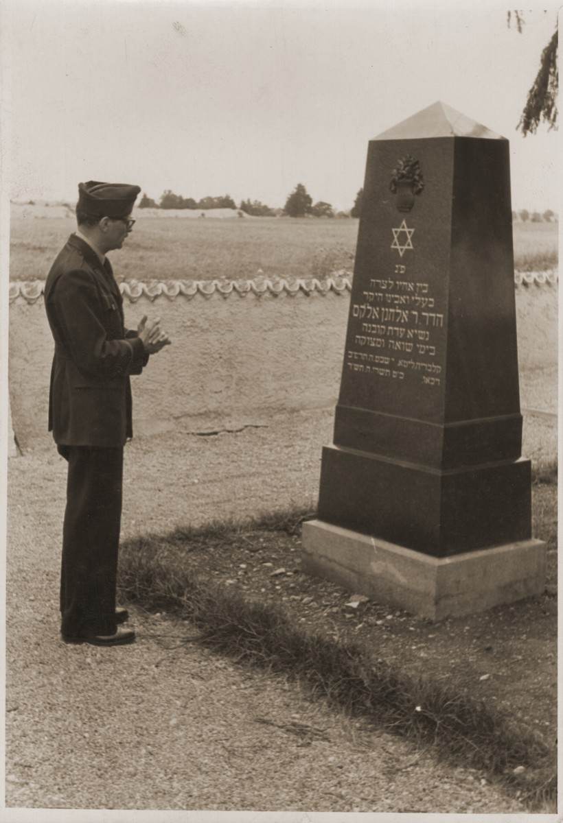 At Dachau, US Army Chaplain Sol Shapiro pays his respects at the grave of former leader of the Kovno Jewish community, Dr. Elkhanan Elkes.