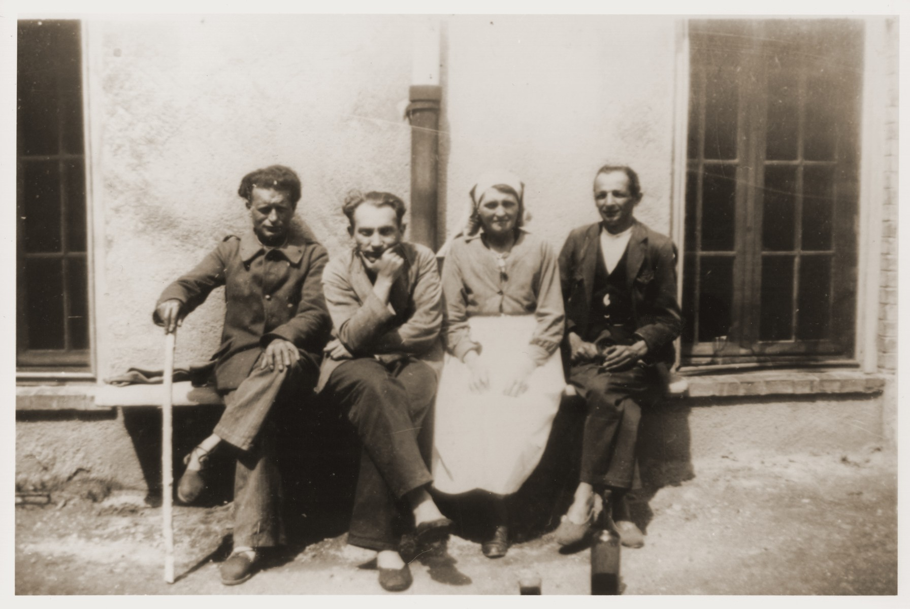 Jakob Rawicz (second from the left) sits outside a barracks in a hospital camp in Aix-en-Provence, where he was transferred from the Les Milles transit camp.