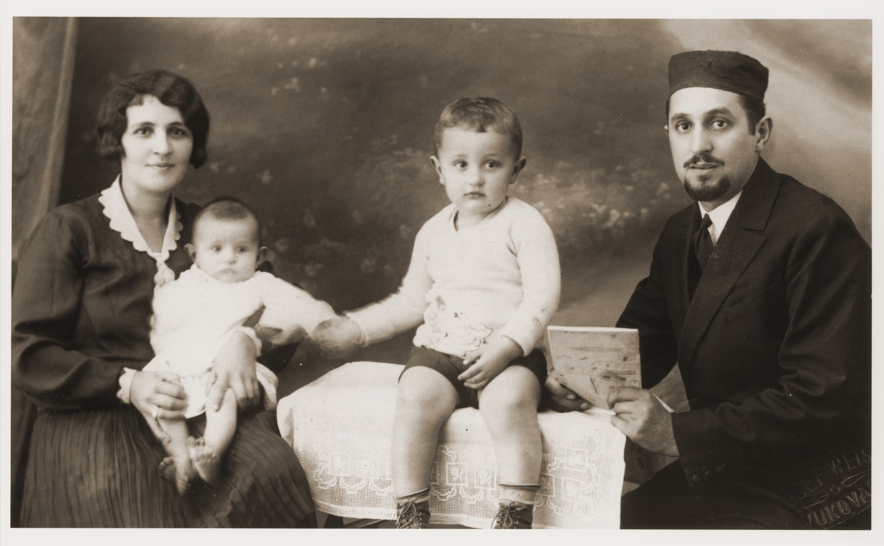Portrait of Helen Berkovic Goldberger, Cantor Eugene Goldberger and their sons Milan and Leo.