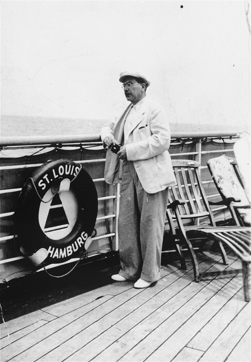 A passenger stands on the deck of the refugee ship MS St. Louis.     From a photo album belonging to St. Louis passenger Moritz Schoenberger.