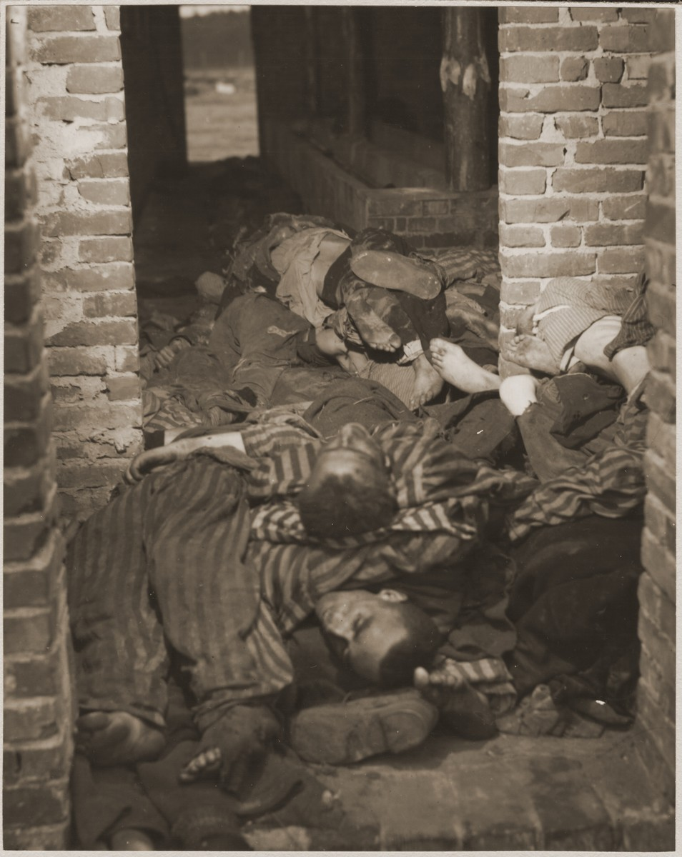 The bodies of prisoners are piled in a brick structure in the newly liberated Woebbelin concentration camp.