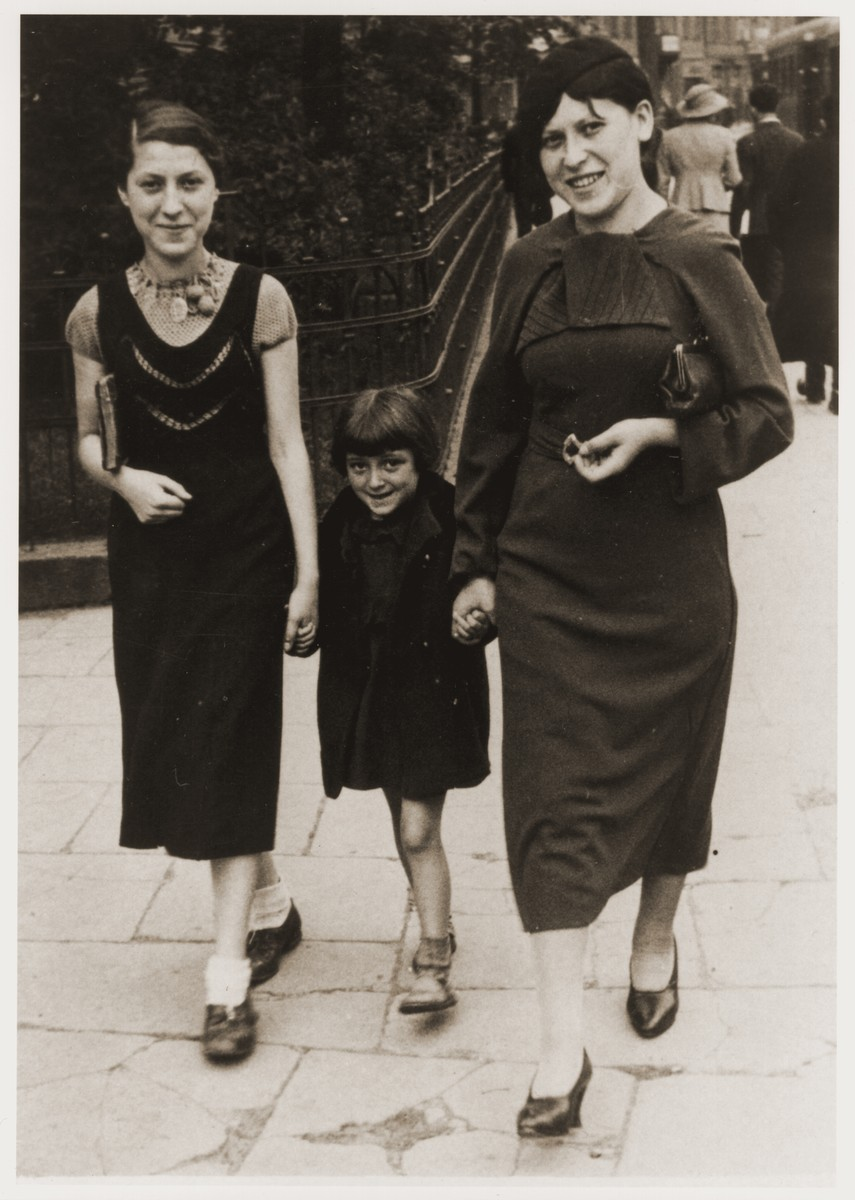 Estera Tenenbaum (left) walks along the streets of Warsaw with her sister, Nechama, and her niece.    This picture was taken on the eve of Estera's departure for the United States.