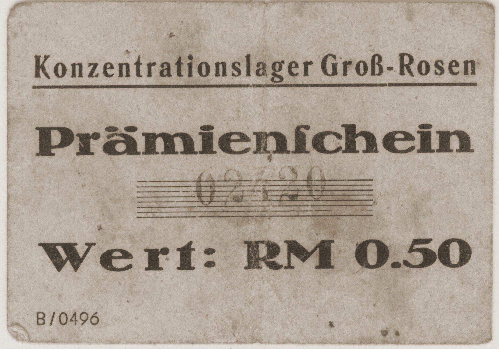 A .50 RM piece of scrip from the Gross Rosen concentration camp that was given to Hanka Granek during her imprisonment at the Peterswaldau sub-camp of Gross Rosen.