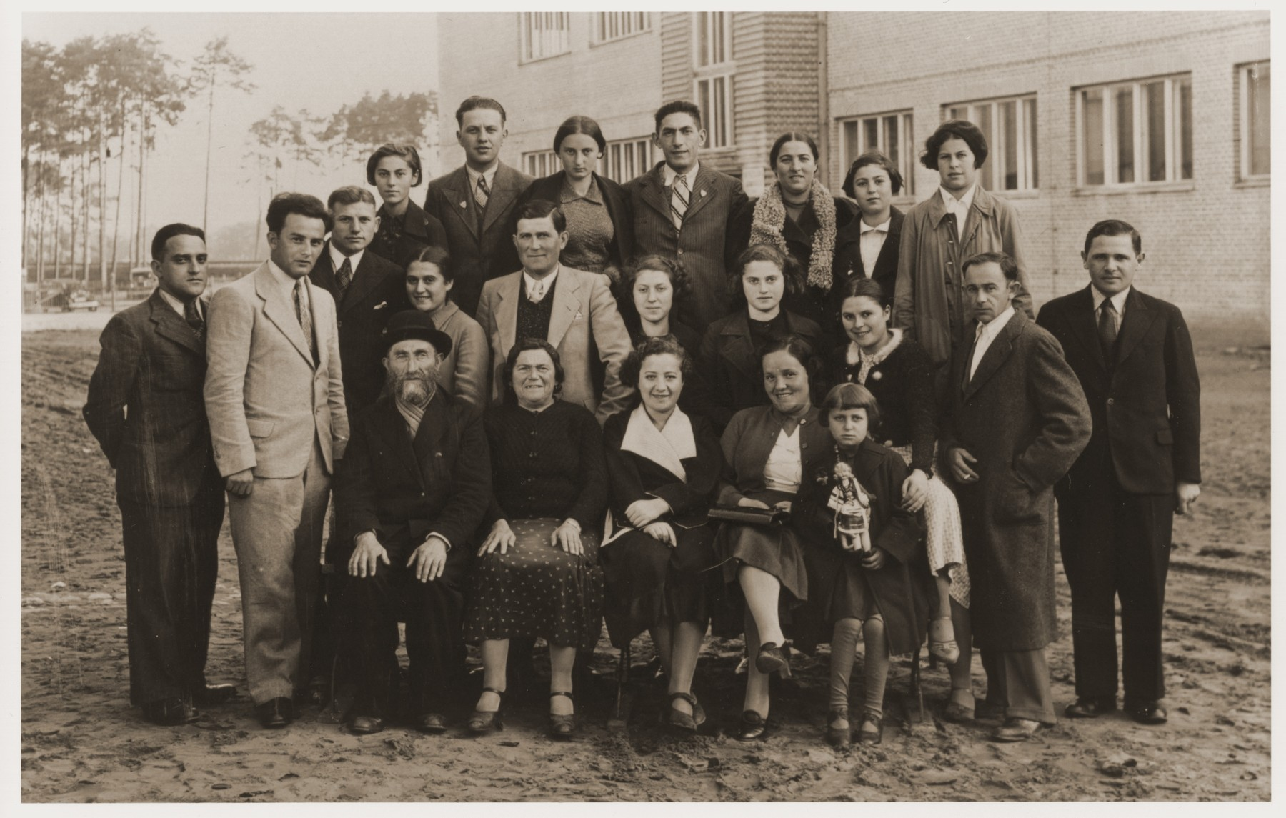 Group portrait of Polish Jews and non-Jews traveling from Warsaw via Gdynia and Le Havre to the United States.    Estera Tenenbaum is pictured fifth from the right in the second row.