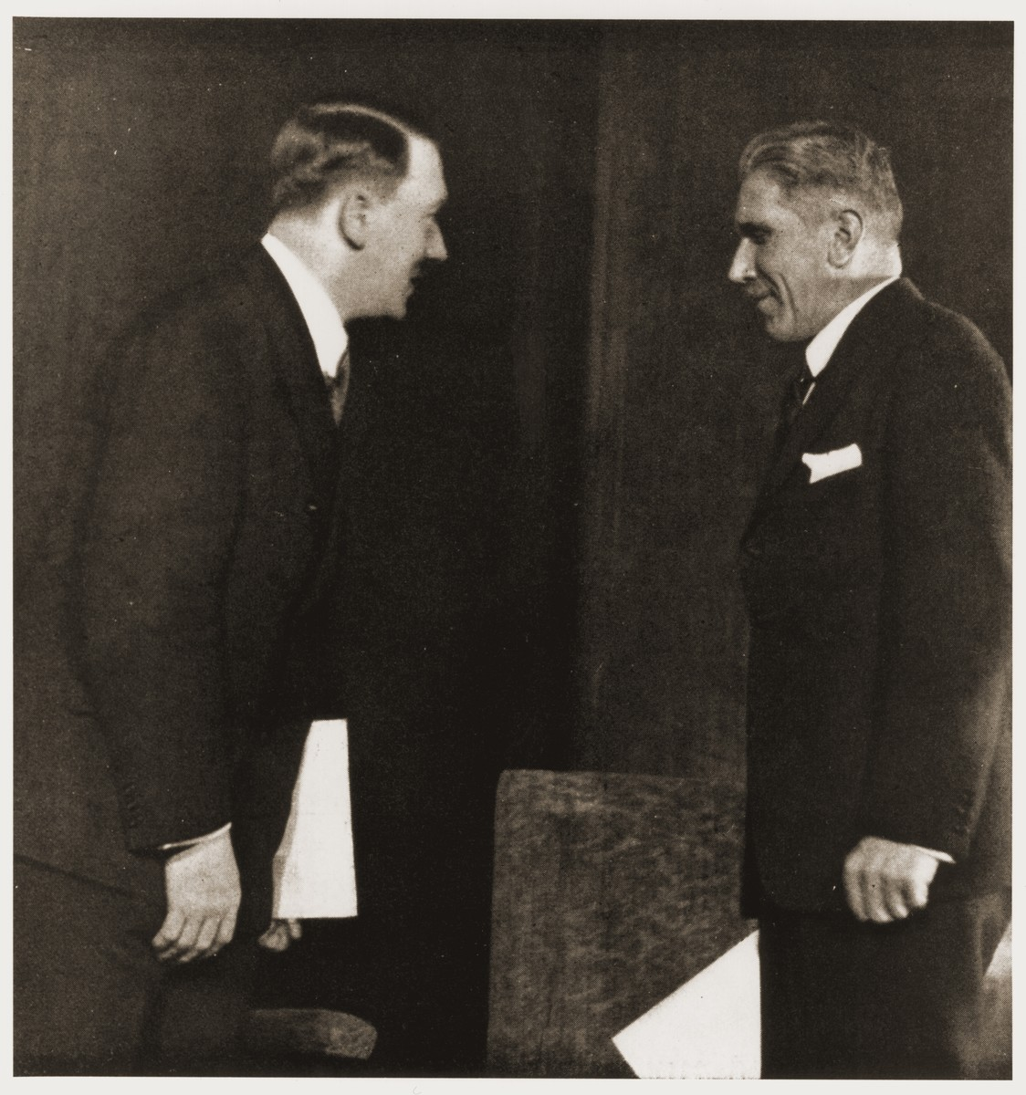 Adolf Hitler converses with Franz von Papen in the Reich chancellery at the first meeting of Hitler's new cabinet.