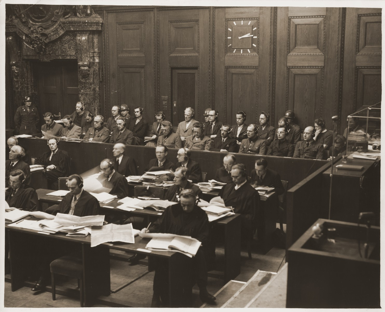 The twenty-three defendants and their lawyers listen to the proceedings of the DoctorsTrial.