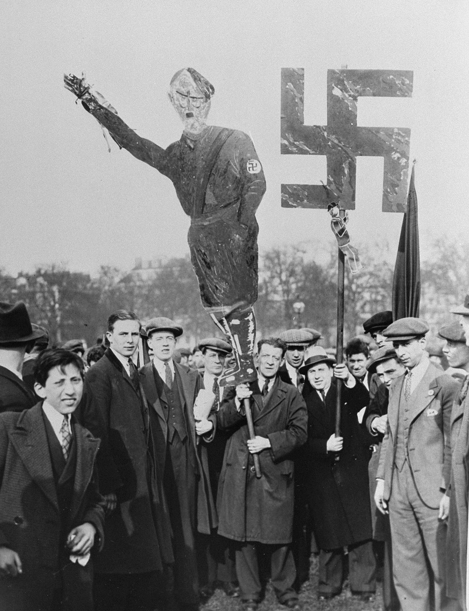 British Jews carry an effigy of Hitler and a large swastika at a mass demonstration in Hyde Park, where thousands are gathered to protest against the Nazi persecution of German Jews.