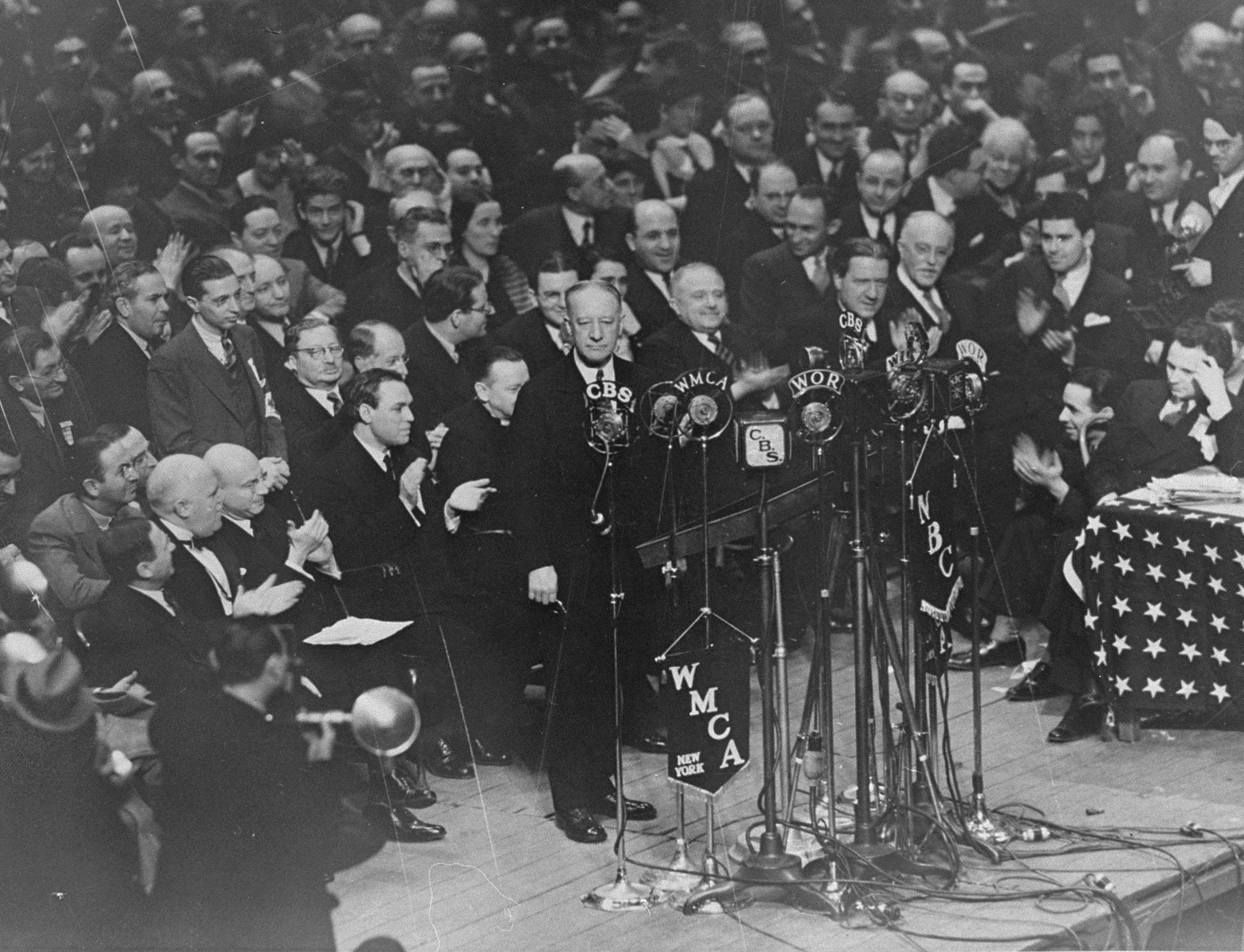 Former Governor Alfred E. Smith addresses the crowd at a mass demonstration held in Madison Square Garden to protest against the Nazi persecution of German Jews.