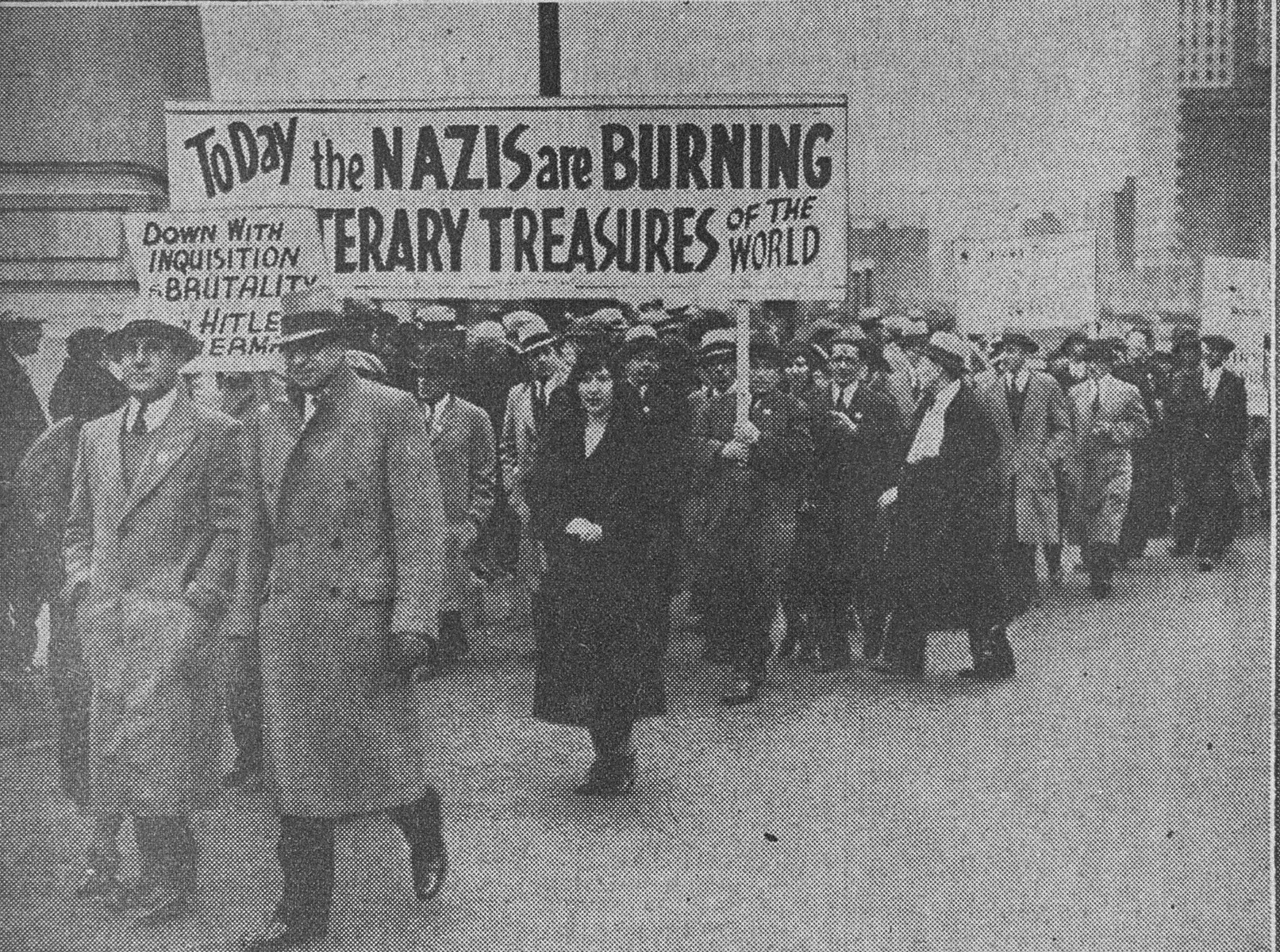 "Jews march in Chicago to protest against the Nazi persecution of German Jews.  The marchers are following a route from Ashland Boulevard and Roosevelt Road to Grant Park, where they will hold a mass meeting.    The original caption in the Chicago Herald Examiner reads, ""Jews Protest Hitler Regime.  A general view of the parade of Chicago Jews who marched yesterday from Ashland Blvd. and Roosevelt Road to Grant Park at  Congress St., where they held a mass meeting of protest against the persecution of the Jewish race by the Hitler regime in Germany."""