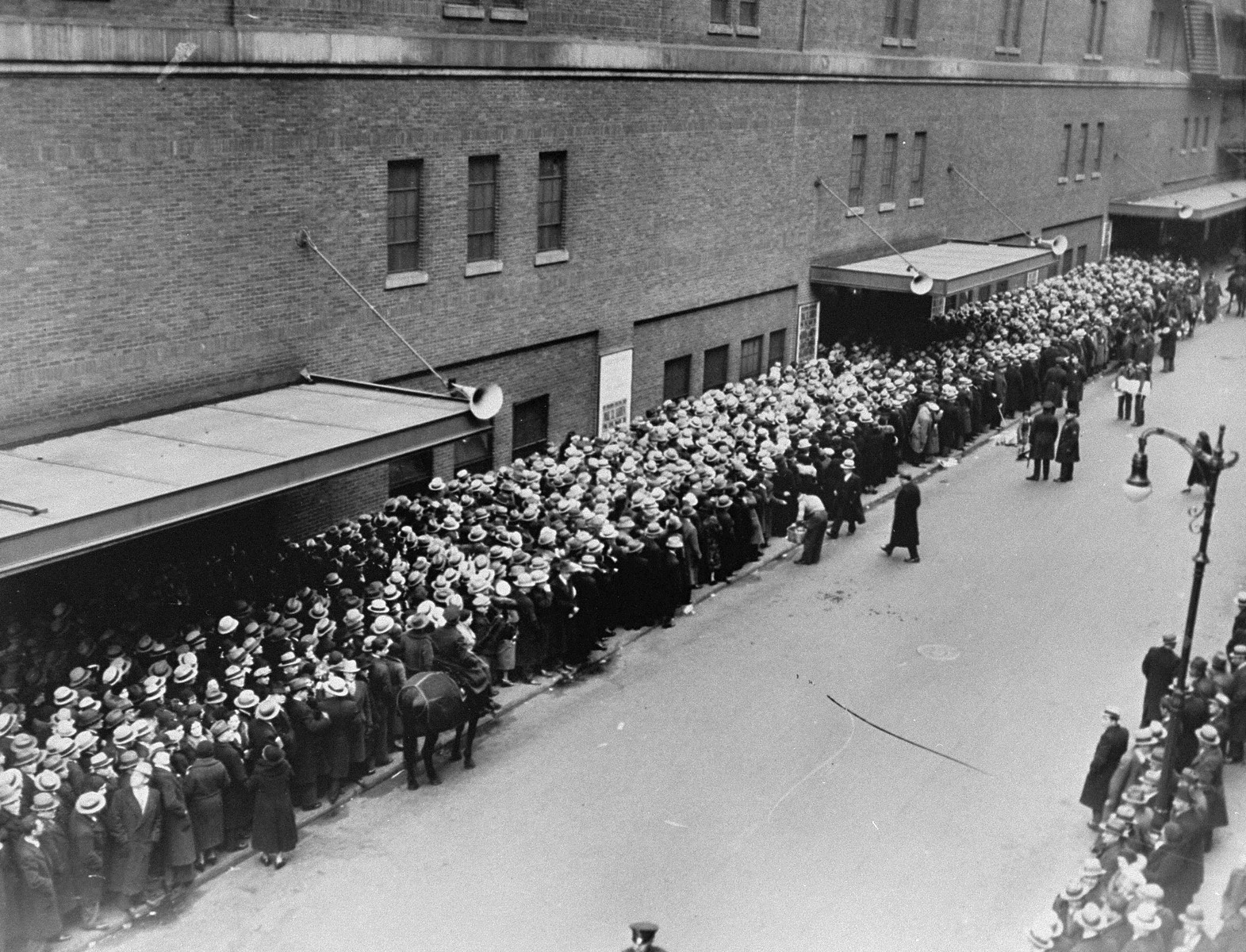 View of people queued up at the entrance to Madison Square Garden, where a mass demonstration is scheduled for later in the day to protest against the Nazi persecution of German Jews.  More than 250,000 people are expected to attend the event which will feature addresses by prominent Catholic, Protestant and Jewish speakers.