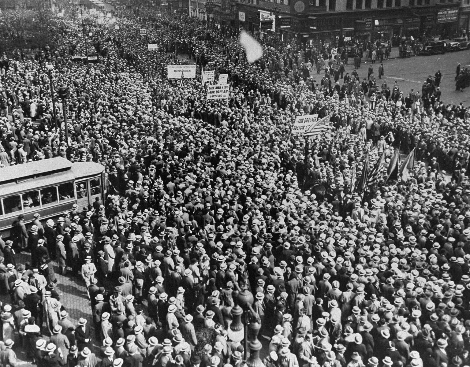 More than a hundred thousand demonstrators gather in front of Madison Square Garden to take part in an anti-Nazi protest march through lower Manhattan.