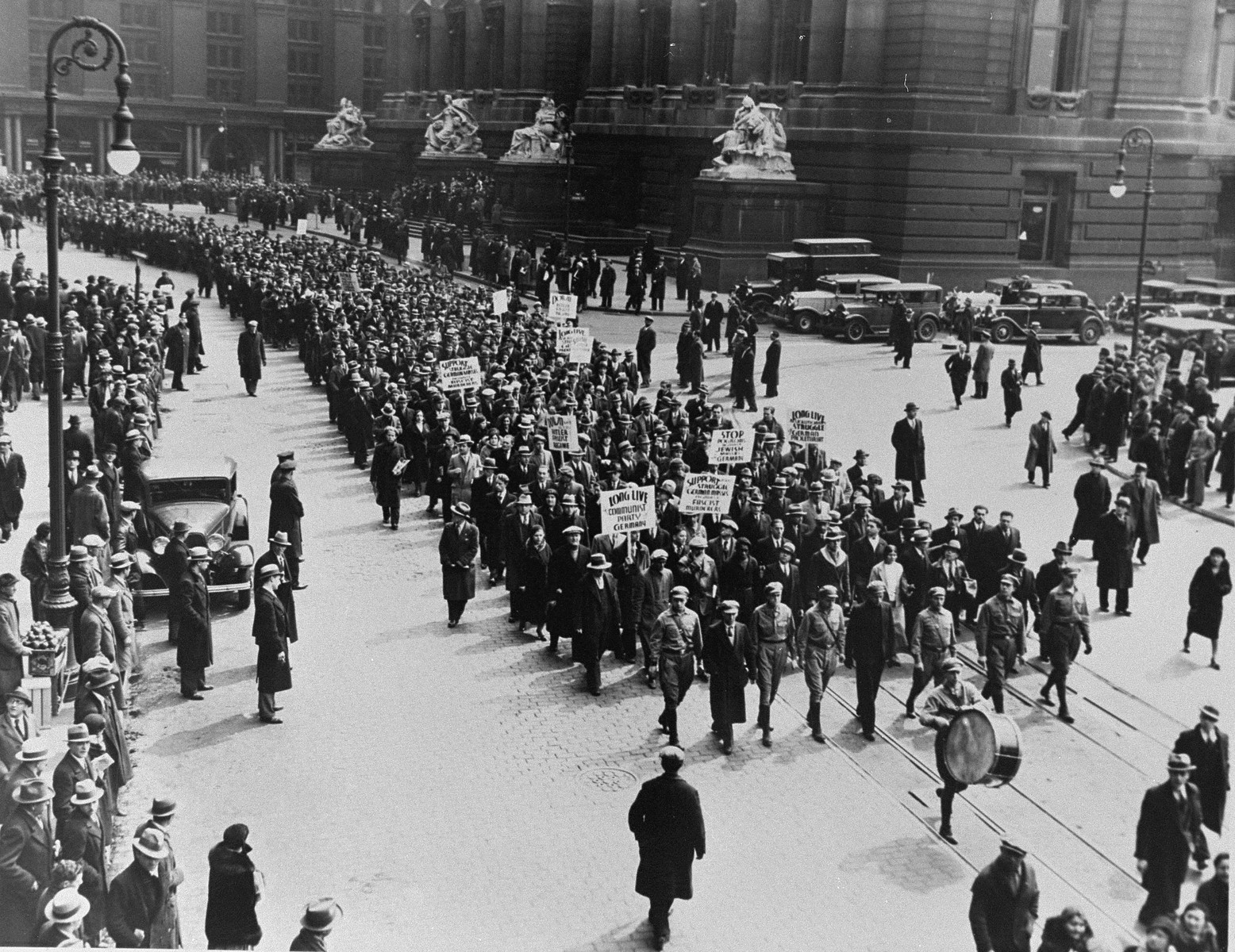 Members of the American communist party participate in a march through the streets of lower Manhattan to protest against the Nazi persecution of German Jews.